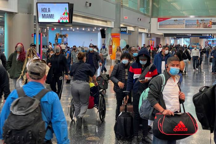 Travelers at Miami International Airport in the midst of the coronavirus pandemic