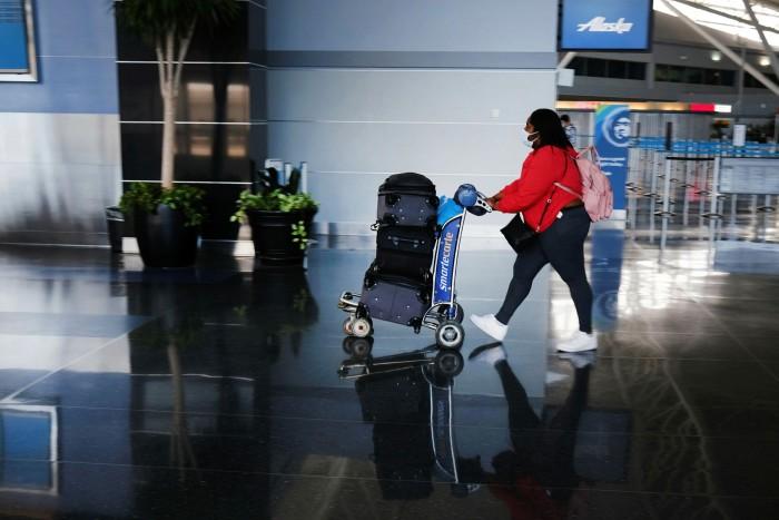A passenger walks through a terminal at John F Kennedy Airport in New York Airport