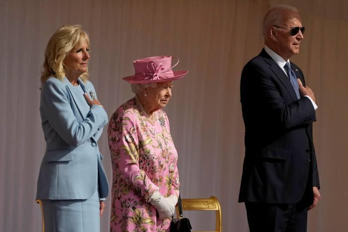 Joe Biden and First Lady Jill Biden with Queen Elizabeth II listen to the National Anthems at Windsor Castle