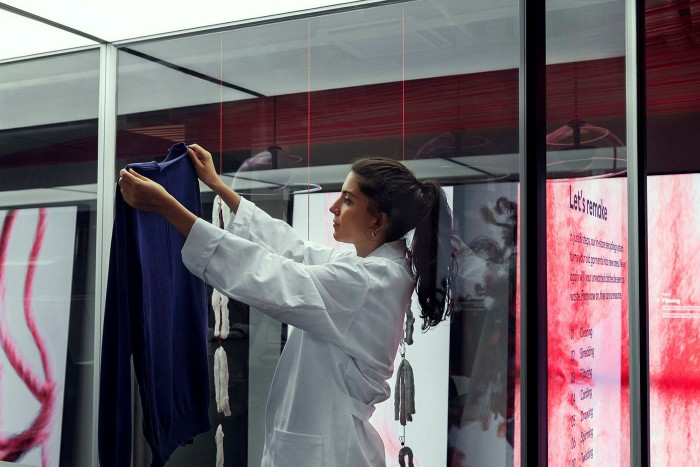 H&M has introduced an in-store recycling machine that shreds garments into fibers that are then spun and knitted into new fashion items