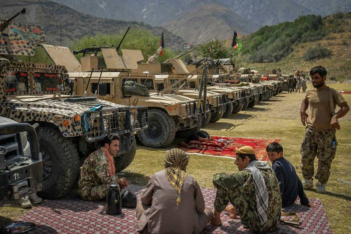 Afghan gunmen in support of Afghan security forces against the Taliban stand with their weapons and Humvee vehicles in Bazarak, Panjshir Province on August 19